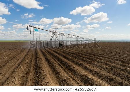 Center-Pivot Irrigation Waterwheel Circle Irrigation Farm Field Agriculture - stock photo