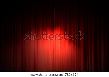 Center stage spotlight against a red velvet curtain