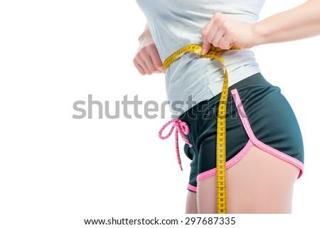 centimeter on a slender female waist - stock photo