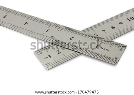 centimetres vs inches, metal rulers on a white background with clipping path - stock photo
