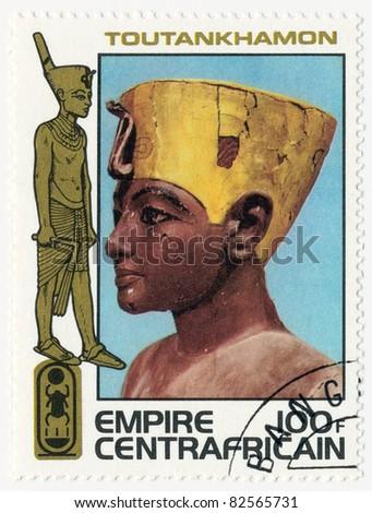 CENTRAL AFRICAN EMPIRE - CIRCA 1978: A stamp printed in Central African Empire shows King wearing crowns of Upper and Lower Egypt, painted wood sculpture, series tutankamen, circa 1978
