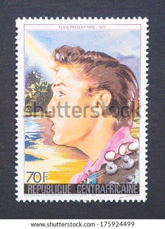 CENTRAL AFRICAN REPUBLIC - CIRCA 1986: a postage stamp printed in Central African Republic showing an image of Elvis Presley, circa 1986.  - stock photo