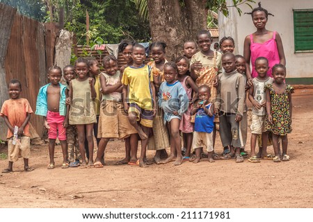 Central African Republic-July 17 unidentified children and woman posing for photography at streets of Bangui on July 17, 2014 in Bangui, Central African Republic - stock photo