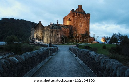 Central alley from Eilean Donan castle at dusk - stock photo