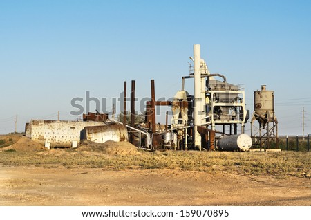 Central Asia. Old asphalt plant. - stock photo