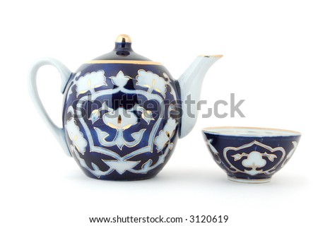 Central Asian (Uzbek) tea pot and tea cup (piala) with traditional cotton style pattern. - stock photo