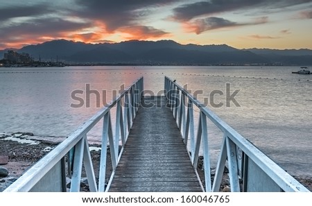 Central beach of Eilat at dawn, Red Sea - stock photo
