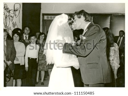 CENTRAL BULGARIA, BULGARIA,- CIRCA 1975: the area Plovdiv - newlyweds - the kiss - circa 1975
