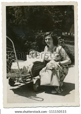 CENTRAL BULGARIA, BULGARIA,- CIRCA 1950: the area Plovdiv - young mother with her baby in a pram - circa 1950