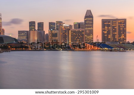 Central business district of Singapore and promenade at sunrise - stock photo