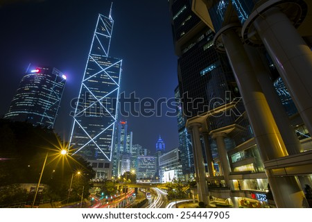 Central District Hong Kong - Feb, 2015: Bank of China Tower and Cheung Kong Center in Central District of Hong Kong. Both buildings are skyscrapers, stunning night view and skyline for Hong Kong. - stock photo