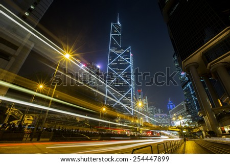 Central District Hong Kong - Feb 3, 2015: Bank of China Tower in Central District of Hong Kong. Buildings are skyscrapers, stunning night view and skyline for Hong Kong. - stock photo