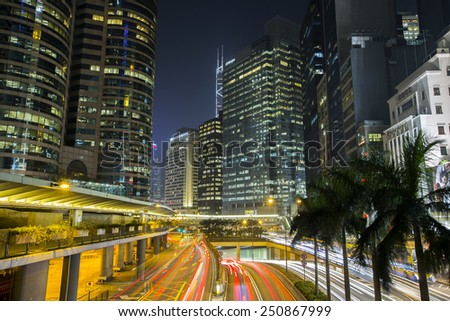 Central District Hong Kong - February 3, 2015 : The skyscrapers at night in Central Hong Kong. A main business district many international financial services and headquarters here - stock photo