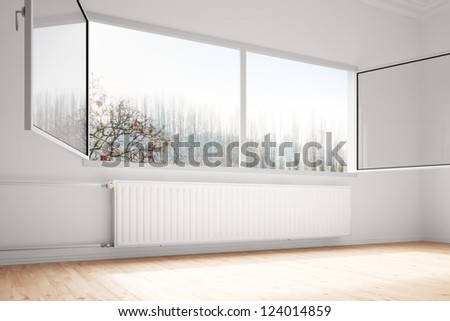 Central heating attachted to wall with open windows - stock photo