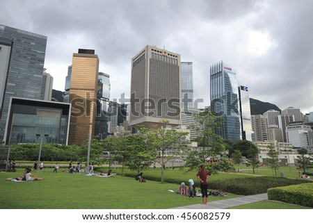 CENTRAL , HONG KONG - JULY 1 : People relaxing at the beautiful garden in the park between the building of Hong Kong in the evening time on July 1 2016.