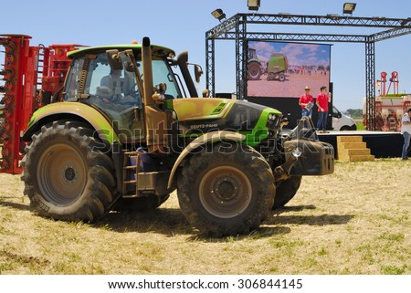 CENTRAL ITALY- JUNE 23: Agricultural fair with free admission, including displays of tractors and agricultural machinery, crowded with farmers and landowners. June 23, 2013 in Latina, Central Italy