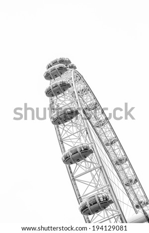 CENTRAL LONDON / ENGLAND - CIRCA AUGUST 2013 - The famous London Eye, one of London's most iconic landmarks is pictured in black and white on a summer day. - stock photo