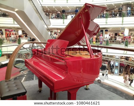 central mall, vashi, navi mumbai, 28th april 2018: a big red color piano placed in a mall