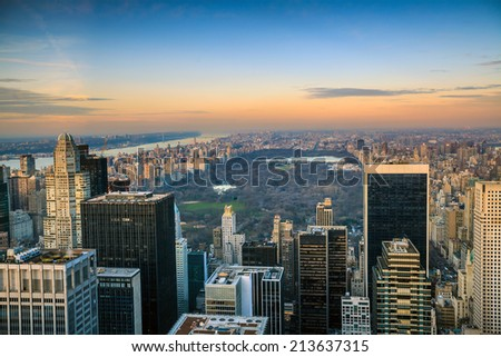 Central Park aerial view, Manhattan, New York; Park is surrounded by skyscraper - stock photo