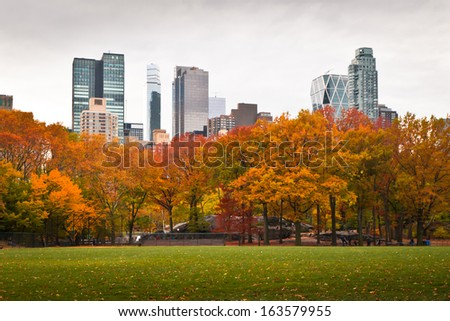 Central Park and its autumn foliage, facing south, from the softball fields. - stock photo