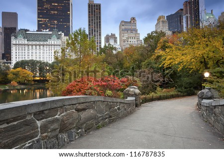 Central Park and Manhattan Skyline. Image of Central Park and Gapstow Bridge in New York City, USA in Autumn. - stock photo