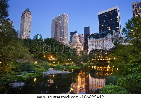 Central Park and Manhattan Skyline. Image of the midtown Manhattan skyline taken from Central Park, New York City. - stock photo