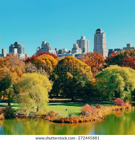 Central Park Autumn and midtown skyline over lake in Manhattan New York City - stock photo