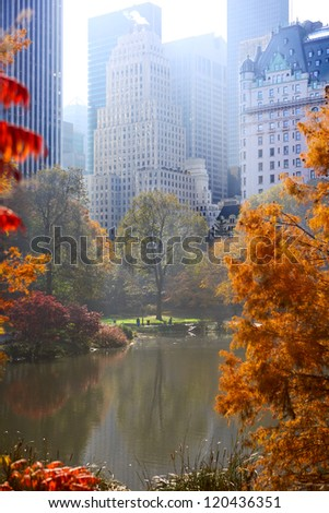 Central Park in autumn and Manhattan skyscrapers, New York City - stock photo