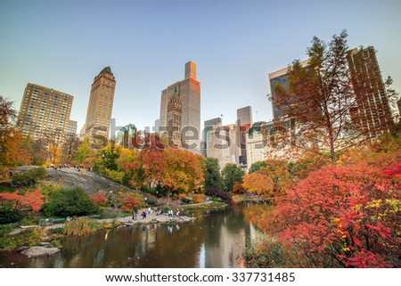 Central Park in Autumn with colorful trees and skyscrapers  - stock photo
