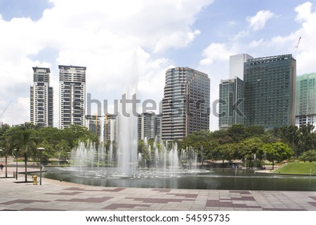 central park in kuala lumpur, fountains in front of petronas towers - stock photo