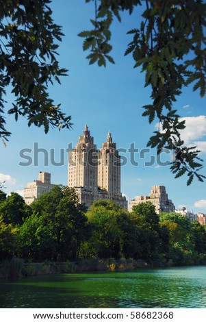 Central park in New York City Manhattan with trees and skyscrapers with lake reflection	 - stock photo
