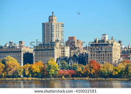 Central park Manhattan east side luxury building over lake in Autumn in New York City. - stock photo