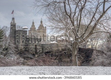 Central Park, New York City after snow storm in March with spring coming Belvedere Castle - stock photo