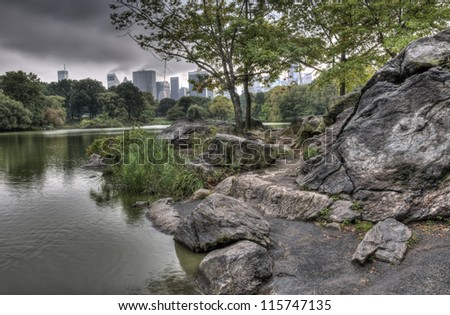 Central Park, New York City at the lake at sunset with ominous clouds
