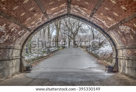 Central Park, New York City during snow storm in late March looking out from tunnel - stock photo