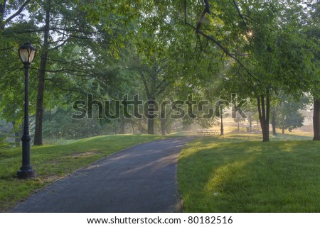 Central Park, New York City early morning on sidewalk - stock photo