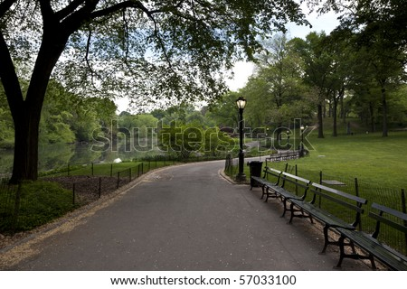 Central Park - New York City sidewalk near the lake - stock photo