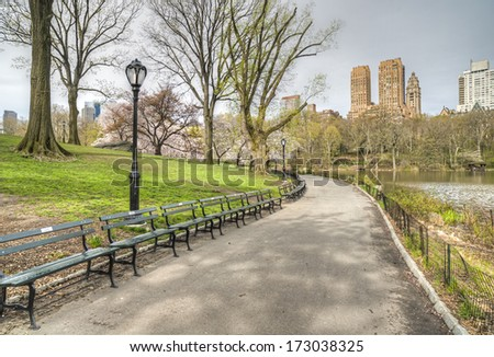 Central Park, New York City spring scene on cloudy day - stock photo