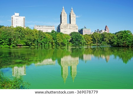 Central Park, New York City, Usa: pond, reflections, skyline, skyscrapers and the San Remo Building on September 14, 2014. The San Remo Building, known as the famous landmark, was opened in 1930 - stock photo