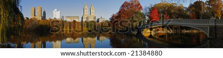 Central Park (New York) Panorama in Fall from the South side of the Lake and looking NW.  Visible structures include Majestic Apartments (left), San Remo Apartments (middle), and Bow Bridge (right). - stock photo