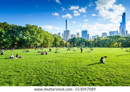 Central Park, New York, USA - 23 October, 2016: people laying on green grass.