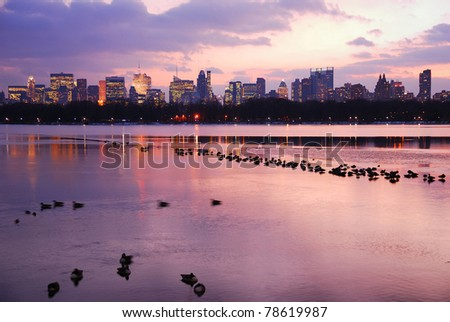 Central Park Sunset with New York City Skyline and dusks in lake - stock photo