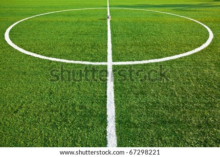 Central part of a football (soccer) field is made from synthetic lawn - stock photo