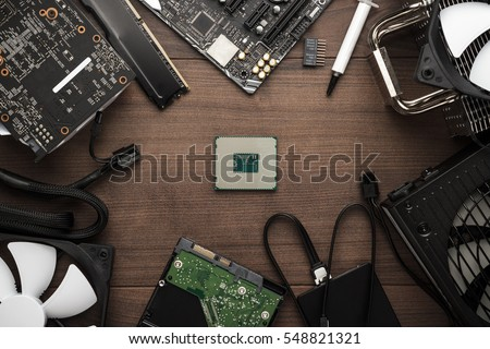 central processing unit and other computer parts on the wooden table. building personal gaming and video production pc concept
