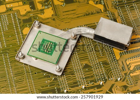 Central Processing Unit (CPU) on heatsink (cooler) - stock photo