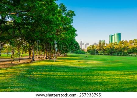 Central public park at evening twilight, Bangkok Thailand - stock photo