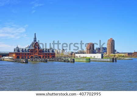 Central Railroad of New Jersey Terminal, USA. Hudson Waterfront. Hudson River. Ferry slips serving boats. - stock photo
