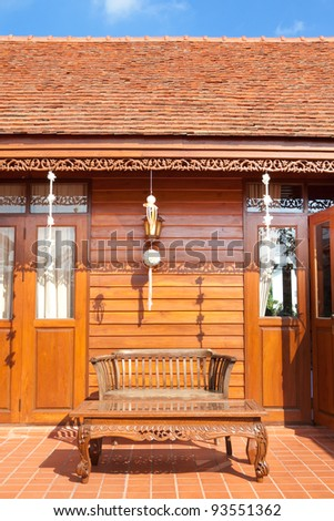 Central wooden veranda in a traditional Thai house - stock photo