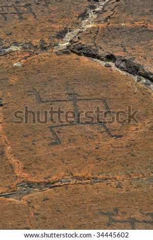 Centuries-old carvings produced by indigenous Hawaiians - stock photo