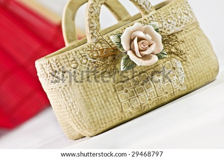 ceramic basket with rose ornament